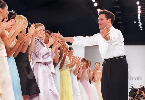 Designer Isaac Mizrahi pays tribute to the models who wore his spring/summer fashion collection at a show in New York in November 1995. He chronicles his unlikely path into the fashion industry in his new memoir, <em>I.M.</em>