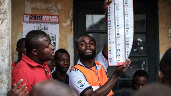 Officials count votes at a polling station in southern Nigeria during the country's election, which came a week later than expected.