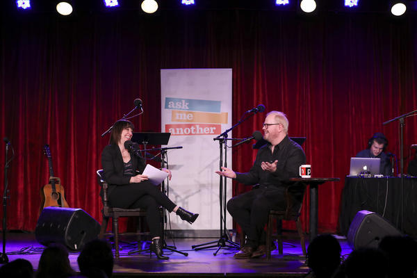 Host Ophira Eisenberg chats with comedian Jim Gaffigan on Ask Me Another at the Bell House in Brooklyn, New York.