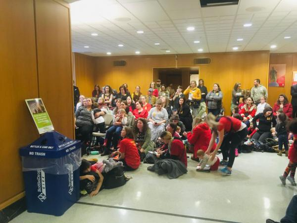 <p>Opponents of a bill to eliminate non-medical vaccine exemptions watch a hearing on the bill in an overflow area at the Capitol in Salem, Ore., Thursday, Feb. 28, 2019.</p>
