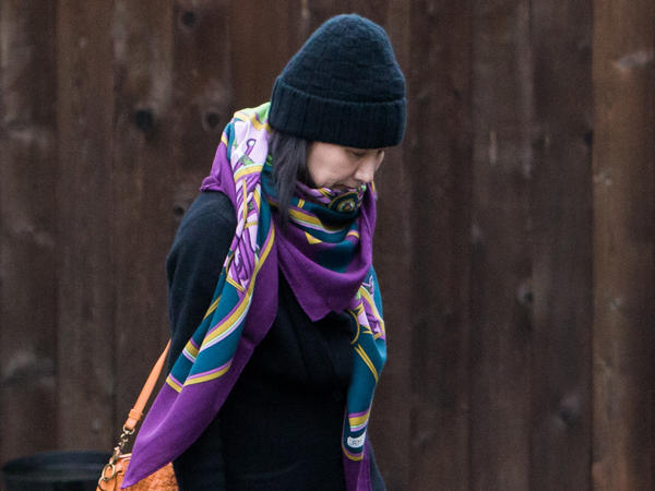 Meng Wanzhou, chief financial officer of Chinese telecom company Huawei, is seen here leaving her home under the supervision of security in Vancouver, British Columbia, in December. On Friday, Canada said that an extradition hearing in Meng's case can proceed.
