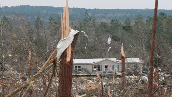 """A tornado-damaged house is seen March 4 in Beauregard, Ala. Rescuers in Alabama were set to resume search operations Monday after tornadoes killed 23 people, uprooted trees and caused """"catastrophic"""" damage to buildings and roads.""""The devastation is incredible,"""" Lee County Sheriff Jay Jones told the local CBS affiliate late Sunday."""