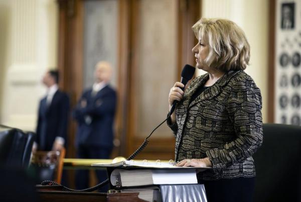 Sen. Jane Nelson, R-Flower Mound, introduces a bill to provide teachers pay raises, on the Senate floor Monday.