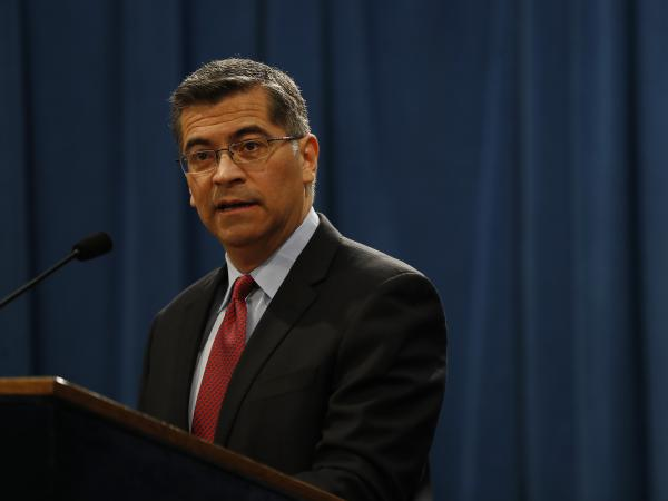 California Attorney General Xavier Becerra announced Tuesday that the two Sacramento police officers who killed Stephon Clark last year will not face criminal charges. Becerra is seen here during a press conference last year.