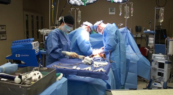 Physicians at the University of Kansas Hospital perform surgery. Some KU doctors are weighing in on new rules for distributing livers for transplant.