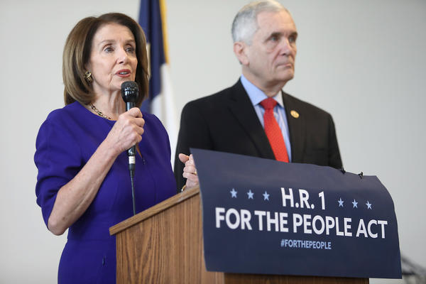 House Speaker Nancy Pelosi and Rep. Lloyd Doggett speak at a news conference Tuesday about legislation to protect voting rights.