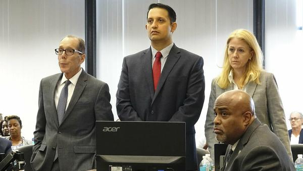 Nouman Raja (center) stands with his defense team at his trial in West Palm Beach, Fla. Raja, a former Palm Beach Gardens police officer, was convicted for shooting and killing stranded motorist Corey Jones in 2015.