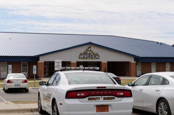 A Johnston County Police Car sits outside Smithfield-Selma High School in North Carolina. North Carolina has relatively permissive gun laws compared to other states.