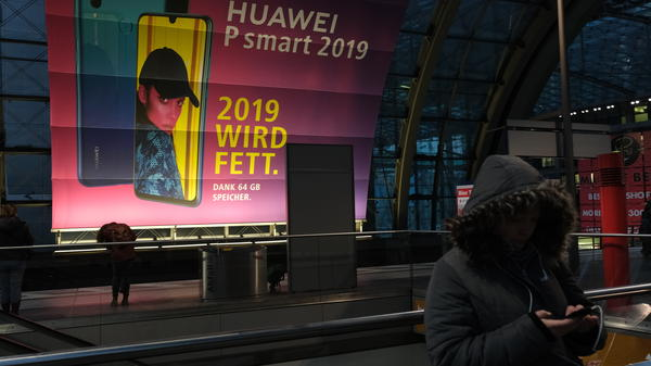 The U.S. has warned Germany about possible repercussions of using Huawei in its upcoming 5G mobile network, citing security concerns. Here, a billboard for the Chinese telecom giant is seen in the Berlin Hauptbahnhof railway station.
