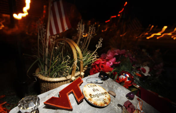Flowers, buttons, and other items adorn a rock which is part of a semi-circle of stones at the makeshift memorial for the Virginia Tech shooting victims on the Drillfield of the Virginia Tech campus in Blacksburg, Va., Wednesday, June 13, 2007.