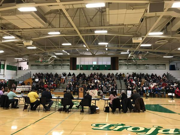 Dwight's village board moved its Monday meeting to Dwight Township High School to accomodate a crowd of several hundred people.