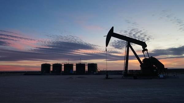 Pumpjacks like this one dot the desert of southeast New Mexico, as oil and gas companies rush to develop one of the largest oil reserves in the world.
