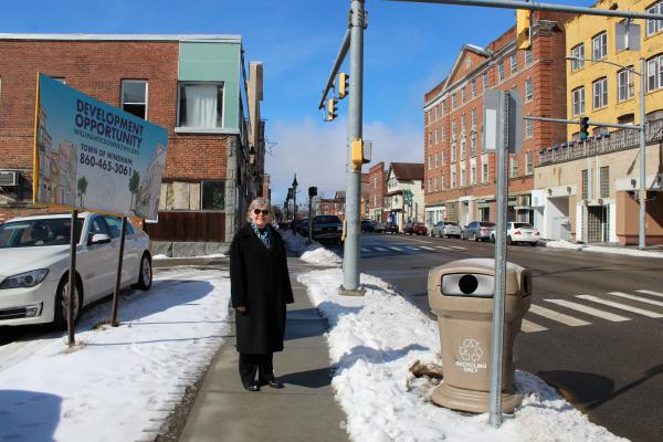 Conn. State Rep. Susan Johnson stands on Main Street in downtown Willimantic. Johnson is sponsoring legislation to tear down historic properties in order to revitalize the notoriously troubled area.