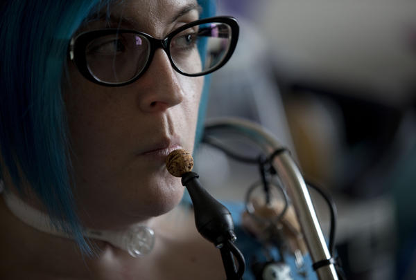Ananda Bennett, a 30-year-old quadriplegic, uses a controller operated by her chin to work her motorized wheelchair and computer at her home in Greensboro, N.C.
