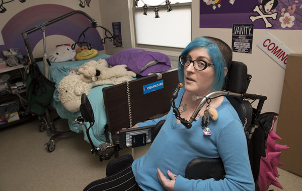 Ananda Bennett, a 30-year-old quadriplegic in her bedroom of a two-bedroom apartment in a retirement community in Greensboro, N.C. Bennett lives in a retirement community because she couldn't find other affordable home to meet her needs.