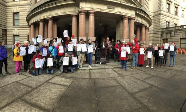 <p>Protesters including the Raging Grannies, as well Oregon Physicians for Social Responsibility, Friends of the Columbia Gorge and high school students from the Portland Youth Climate Council, gathered in front of City Hall to oppose the expansion of Zenith Terminals, which could increase the number of oil trains moving through Portland.</p>