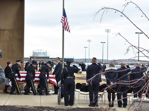 Deputy Keltner's casket leaves Woodstock North High School Wednesday morning for DeFiore Funeral Home.