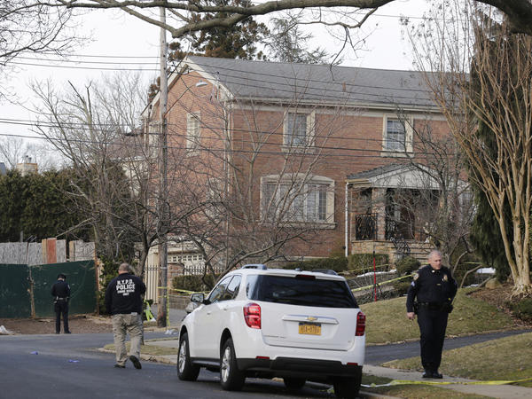 "Police walk near the scene where reputed leader of the Gambino crime family Francesco ""Frank"" Cali, 53, was fatally shot Wednesday night."