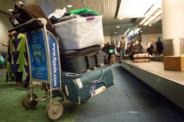 <p>Supporters of House Bill 2508 welcome a family of 11 as they arrive to PDX after a near 36 hour trip from the Democratic Republic of the Congo on Tuesday, Feb. 5, 2019, in Portland, Ore.</p>