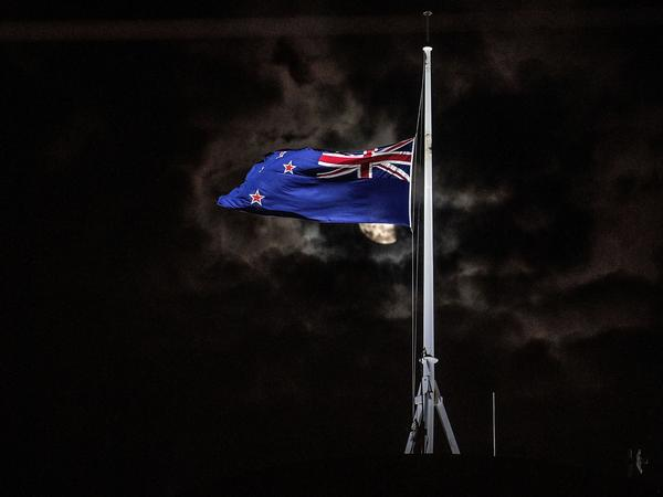 New Zealand's flag is flown at half-staff on a Parliament building in Wellington on Friday after the shootings in Christchurch.