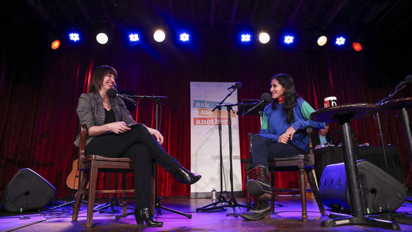 Host Ophira Eisenberg chats with comedian Aparna Nancherla on <em>Ask Me Another</em> at the Bell House in Brooklyn, New York.