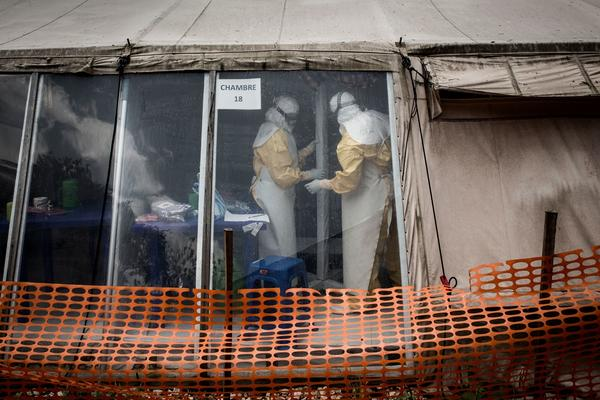 "Health workers inside the ""red zone"" of an Ebola treatment center in Butembo, which was attacked on March 9."
