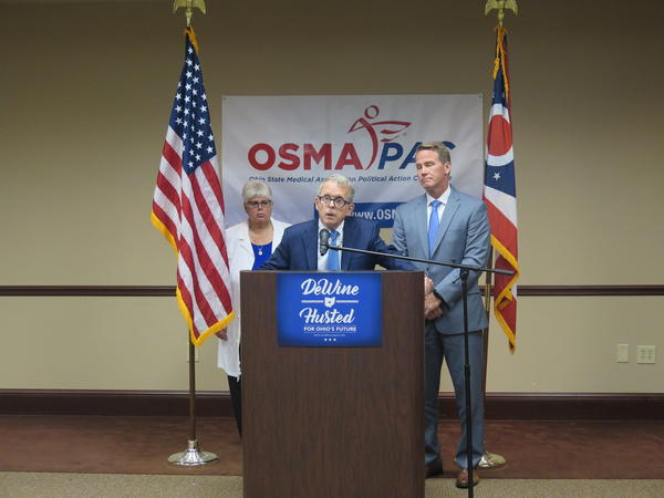 Now-Gov. Mike DeWine (center) speaks at an July 2018 event where he announced he'd keep Medicaid expansion, with work requirements.