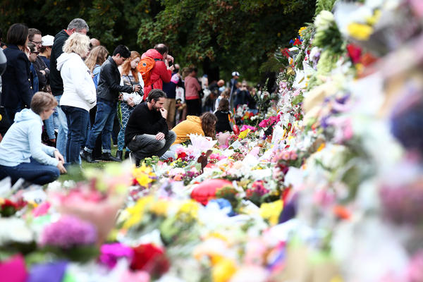 People lay flowers at a memorial for the mosque attack victims on Sunday in Christchurch, New Zealand.