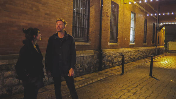 Bell X1's Paul Noonan and <em>World Cafe</em> host Talia Schlanger stand outside of Pablo Picante's where The Dublin Arts Club once stood.