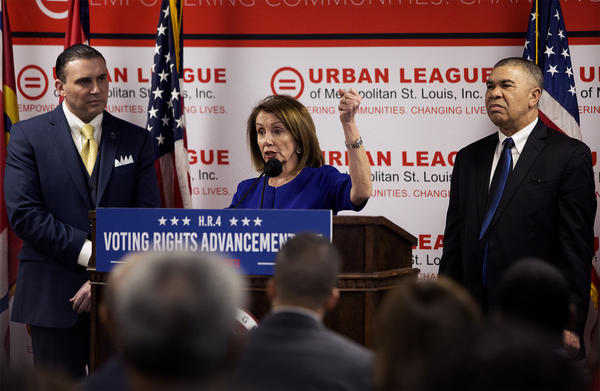 Michael McMillan, left, president of the Urban League of Metropolitan St. Louis, and Rep. Lacy Clay listen as U.S. House Speaker Nancy Pelosi talks about the importance of voting rights at the Ferguson Community Empowerment Center on Monday.