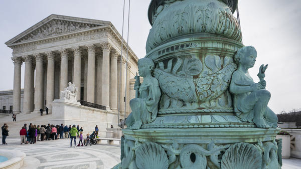 People line up to enter the Supreme Court in Washington, Wednesday.