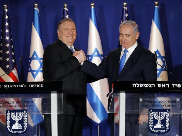 U.S. Secretary of State Mike Pompeo, left, shakes hands with Israeli Prime Minister Benjamin Netanyahu in Jerusalem Thursday.