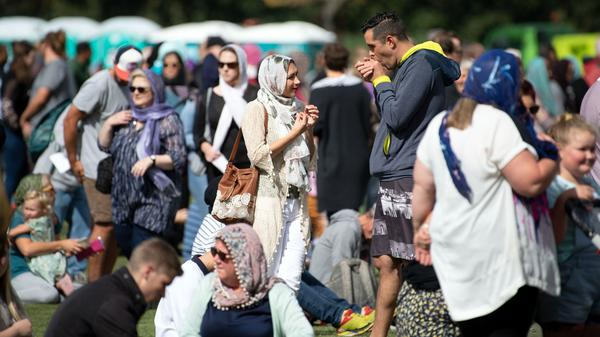 Women wore headscarves as they gathered for the Muslim call to prayer in Hagley Park in Christchurch on Friday. The call was broadcast across New Zealand in memory of 50 people who were killed in attacks at two mosques last Friday.