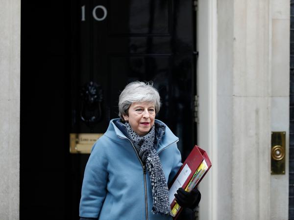 Britain's Prime Minister Theresa May walks out 10 Downing street in London on Wednesday. She announced that if her Brexit deal is approved by Parliament, she will step down from her post.