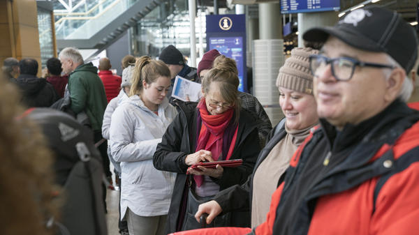 Stranded passengers who had been set to travel with Icelandic airline Wow Air are being forced to book new tickets and absorb unexpected costs after the airline shut down. Here, travelers wait in line at Iceland's international airport on Thursday.