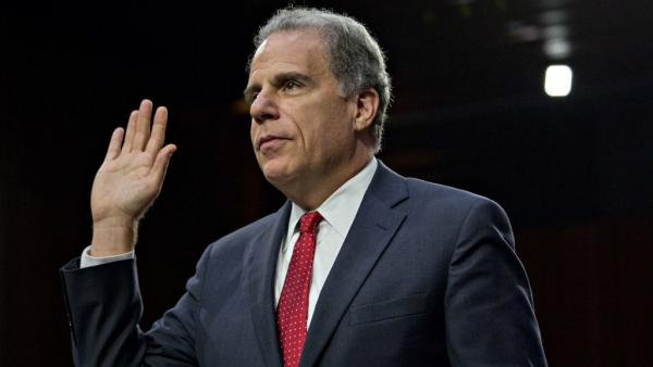 Michael Horowitz, the Department of Justice inspector general, swears in to a Senate Judiciary Committee hearing last year.
