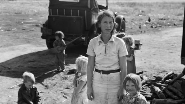 In this November 1936 photo from the U.S. Farm Security Administration, a mother, originally from Oklahoma stands with her five children near Fresno, Calif., where she works as a cotton picker. The Dust Bowl led to a massive migration of Midwestern farmers out of the region, many of whom traveled to California in search of jobs.