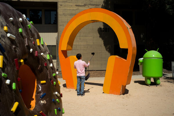 A tourist takes a selfie at Google's sculpture garden in Mountain View, Calif.