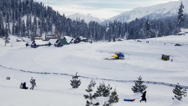 A helicopter brings skiers and snowboarders into the mountains around Gulmarg, in Indian-administered Kashmir