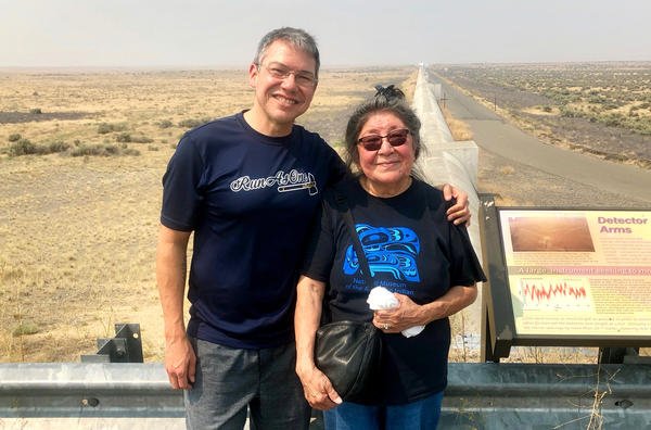Scientist Corey Gray and his mother, Sharon Yellowfly, are pictured at one of the two massive detectors that make up the Laser Interferometer Gravitational-Wave Observatory. One facility, where Gray works, is in Washington state, and the other is in Louisiana.