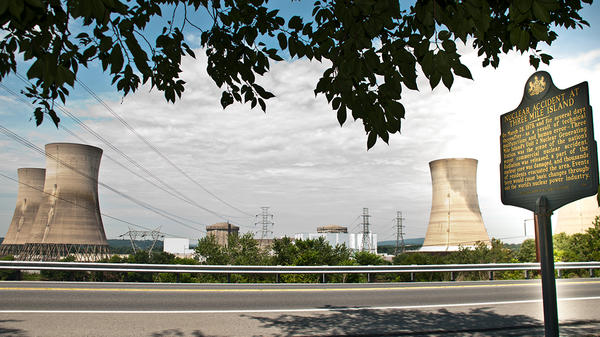 A historical marker commemorates the 1979 nuclear accident at Three Mile Island — the most serious in U.S. history. To the left are the cooling towers for the mothballed Unit 2 reactor, which partially melted down.