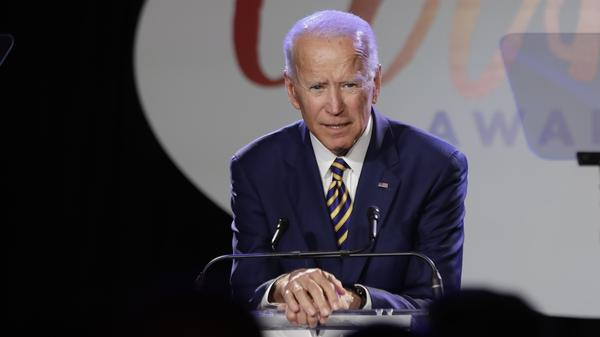 "Former Vice President Joe Biden speaks at the Biden Courage Awards, an event related to combating campus sexual assault, on Tuesday. Activist and former candidate Lucy Flores says Biden touched her in 2014, in an encounter that ""wasn't violent or sexual, it was demeaning and disrespectful."""