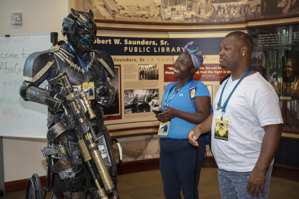 """Retired Army Sgt. Ronald Seaman shows off his """"Tactical Black Panther"""" cosplay at the first AfroCon at the Robert W. Saunders Public Library in Tampa Saturday."""