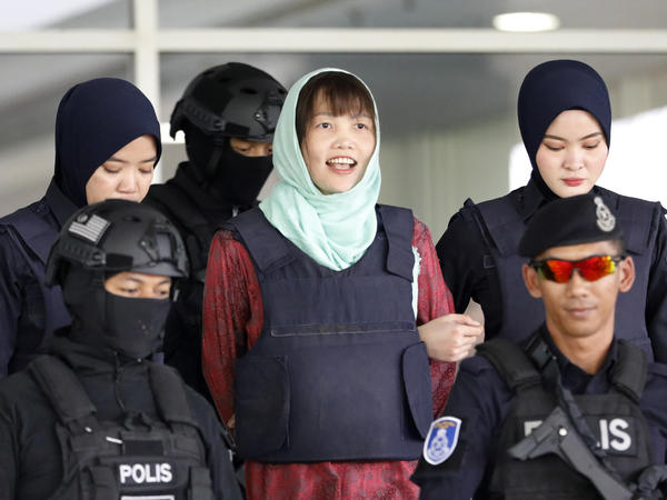 Doan Thi Huong (center) leaves the court in Shah Alam, Malaysia, on Monday. Prosecutors have dropped murder charges against her.