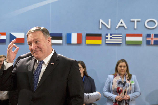 U.S. Secretary of State Mike Pompeo, left, waits for the start of the North Atlantic Council at NATO headquarters in Brussels on Friday, April 27, 2018. (Virginia Mayo/AP)