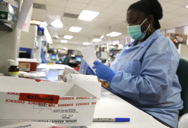 Forensic analyst India Henry works on evidence in a sexual assault case in the biology lab at the Houston Forensic Science Center Thursday, April 2, 2015, in Houston.