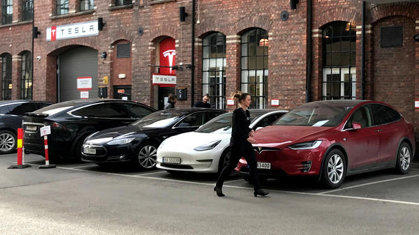 Demand for Tesla Model 3 sedans is driving sales of electric vehicles to new heights in Norway. Here, a Tesla delivery site is seen in Lillestro, Norway.