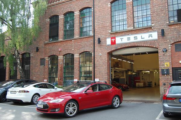 A Tesla Model S electric car leaves a service center in Oslo, Norway, in 2018.