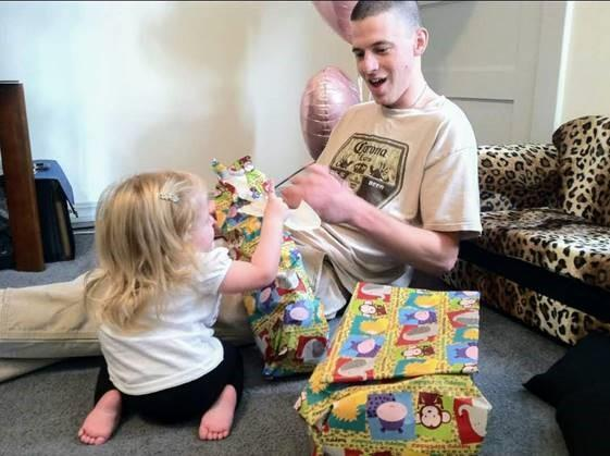 Jeremy Lavender opens gifts with his daughter in an undated photo.