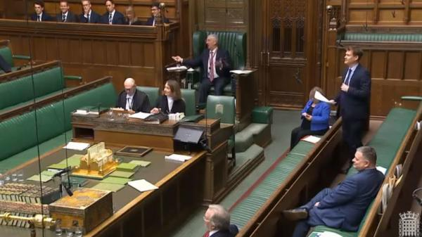 Deputy Speaker Lindsay Hoyle raises his hands in helplessness as water splashes into the House of Commons, forcing an end to business Thursday.